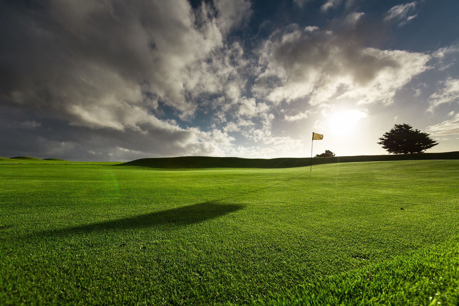 Golfing green with sunset at Holywell Bay Golf, near Newquay