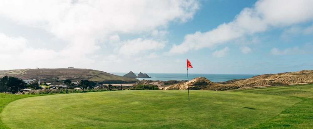 Golf green with view of Gull Rocks at Holywell Bay Golf